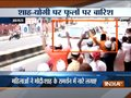 Muslim women showers flower over CM Yogi Adityanath and Amit Shah's convoy in Agra