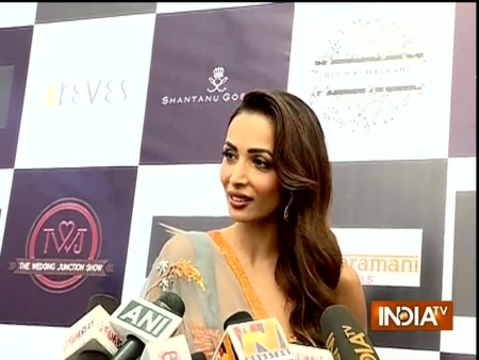 Malaika Arora makes stunning contemporary bride in off-shoulder bridal gown