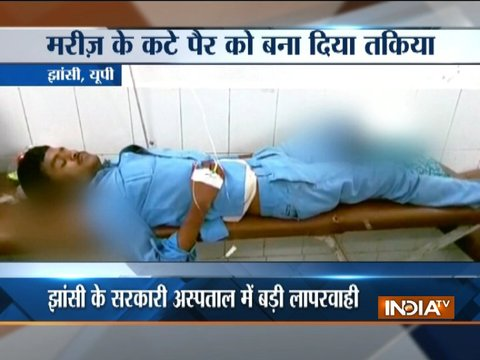 Amputated leg of patient used as pillow at Jhansi hospital, 4 suspended