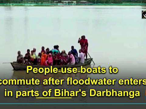 People use boats to commute after floodwater enters in parts of Bihar's Darbhanga