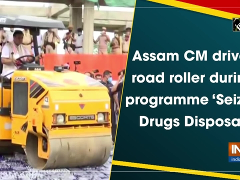 Assam CM drives road roller during programme 'Seized Drugs Disposal'