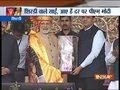 Shirdi: Maharashtra CM Fadnavis honours PM Modi with Shawl, turban and Sai's idol