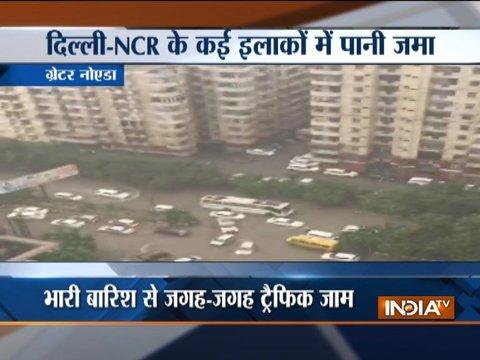Heavy rain lashes Delhi-NCR, roads water-logged, traffic affected