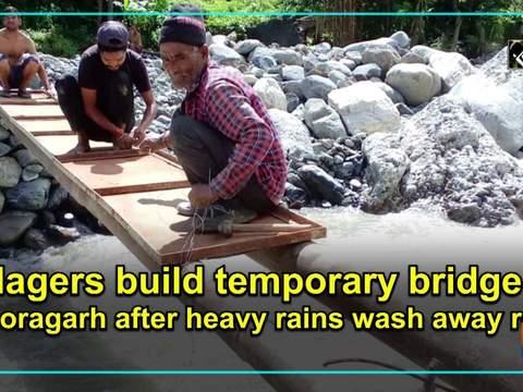 Villagers build temporary bridge in Pithoragarh after heavy rains wash away road