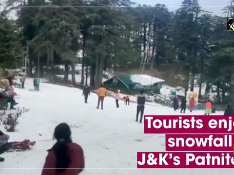 Tourists enjoy snowfall in J&K's Patnitop