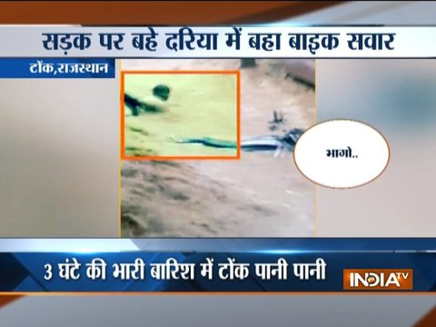 Boy washed away with bike while crossing flooded road in Rajasthan