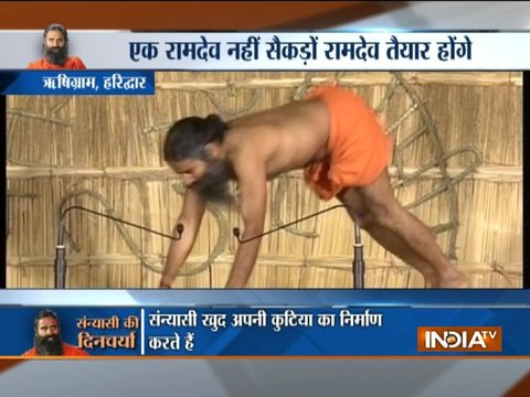 Swami Ramdev performs yoga with 90 sanyasis at Rishigram in Haridwar