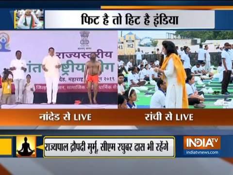 Baba Ramdev performs yoga along with Maharashtra CM Devendra Fadnavis in Nanded on International Day of Yoga