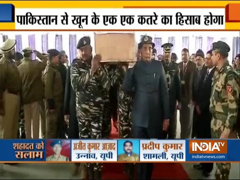 Pulwama Attack: Rajnath Singh lends a shoulder to mortal remains of a CRPF soldier