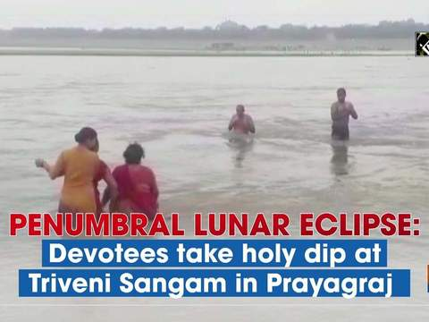 Penumbral lunar eclipse: Devotees take holy dip at Triveni Sangam in Prayagraj