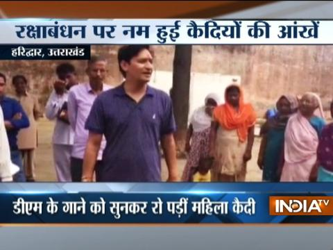 Haridwar DM sings song for lady prisoner in jail after they tied rakhi to him