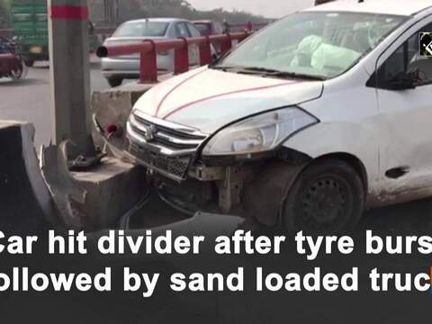 Car hit divider after tyre burst followed by sand loaded truck