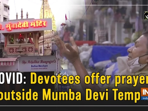 COVID: Devotees offer prayers outside Mumba Devi Temple