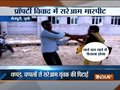 Watch: Woman thrashes man over property dispute in UP's Mainpuri