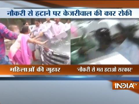 Former employees of a state Govt hospital protest in front of Delhi CM Kejriwal's car
