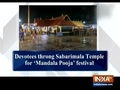 Devotees throng Sabarimala Temple for 'Mandala Pooja' festival