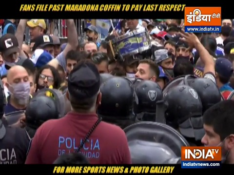 Fans scramble to catch a glimpse of Maradona's coffin