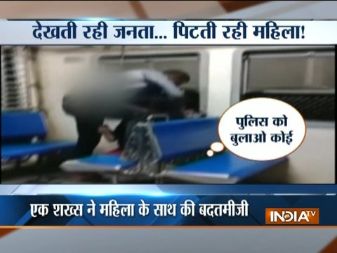 Passengers watch as man assaults woman at Mumbai local