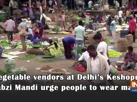 Vegetable vendors at Delhi's Keshopur Sabzi Mandi urge people to wear masks