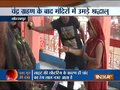 Devotees take a holy dip in river Ganga, visit temple following Chandra Grahan