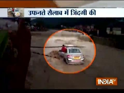 Uttarakhand: Car stuck in rapid flow of flood water in Dehradun