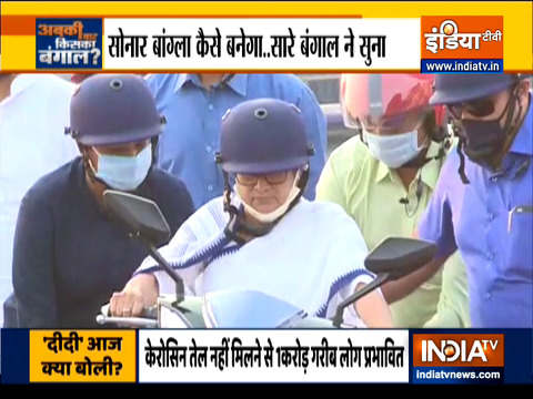 CM Mamata Banerjee drives electric scooty to protest against rising fuel prices