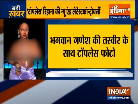 Popstar Rihanna poses topless with Ganesha figurine necklace