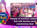 People of Amritsar celebrate Holi with flowers amid coronavirus fear