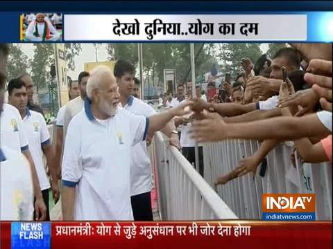 PM Modi interacts with people after performing yoga in Ranchi