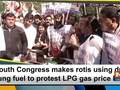 Youth Congress makes rotis using dry dung fuel to protest LPG gas price hike