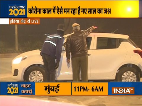 Police urge public to clear the road as night curfew takes effect from 10 pm in Delhi and Mumbai