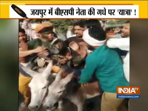 BSP national coordinator face blackened by workers, paraded on donkey through the streets in Jaipur