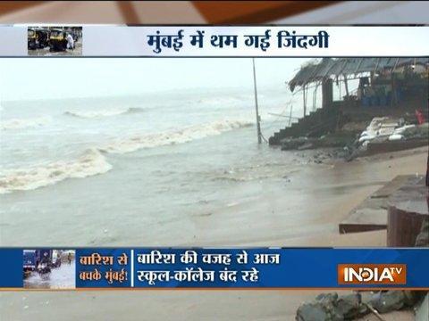 Heavy rains lash Mumbai, schools shut, flights hit