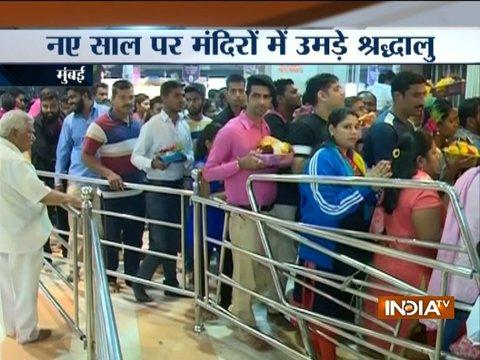 Devotees thong to Siddhivinayaka, Shirdi temple on first day of new year