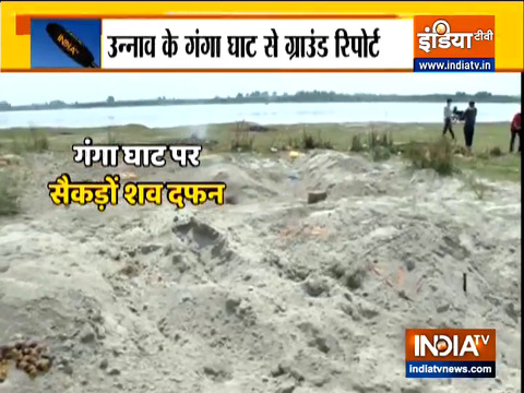 dead bodies found buried on banks of Ganga in unnao