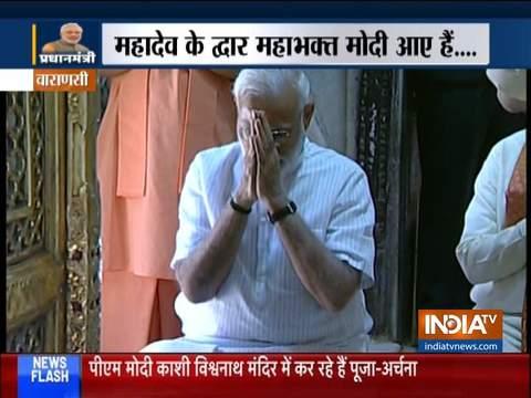 PM Narendra Modi, Amit Shah offer prayers at Kashi Vishwanath temple