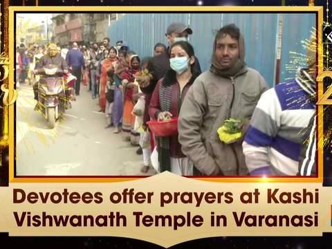 Devotees offer prayers at Kashi Vishwanath Temple in Varanasi