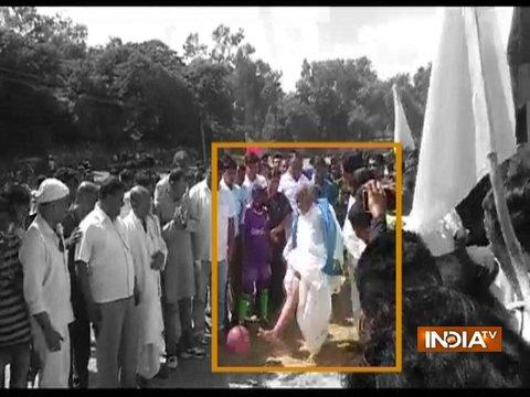 Bihar Minister falls down while kicking football during a tournament in Nalanda