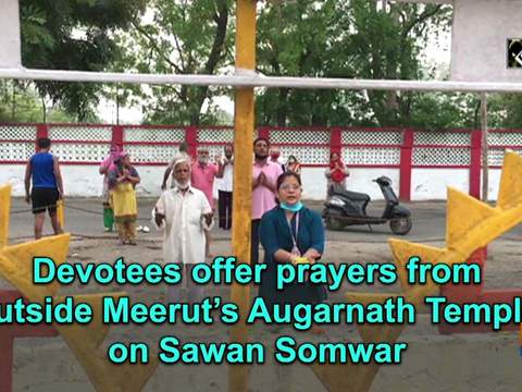 Devotees offer prayers from outside Meerut's Augarnath Temple on Sawan Somwar