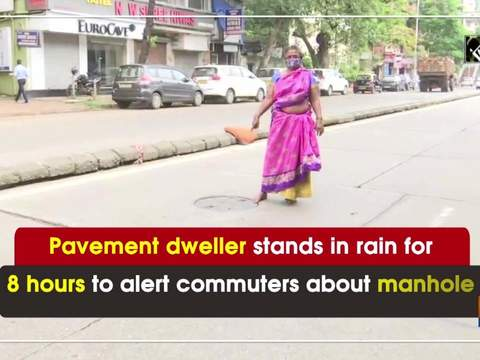 Pavement dweller stands in rain for 8 hours to alert commuters about manhole
