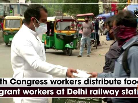 Youth Congress workers distribute food to migrant workers at Delhi railway station