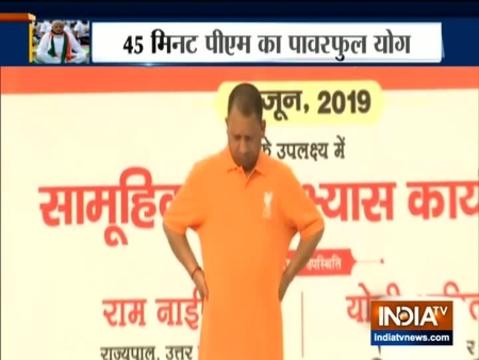 CM Yogi Adityanath performs neck exercises in Lucknow on International Yoga Day