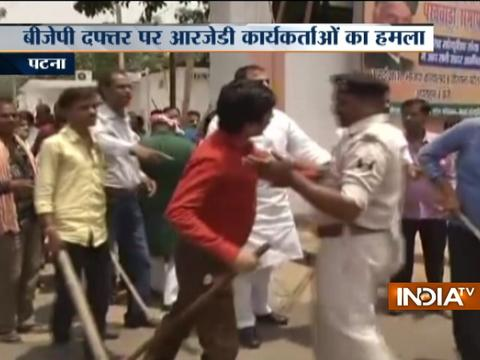 RJD workers attack BJP office in Patna a day after IT dept raids Lalu Yadav