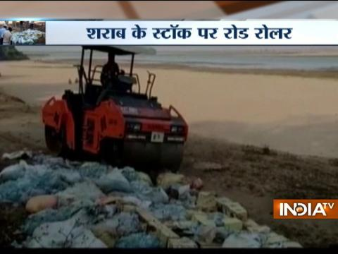 Bottles and pouches containing liquor crushed by Bihar Police in Rohtas district